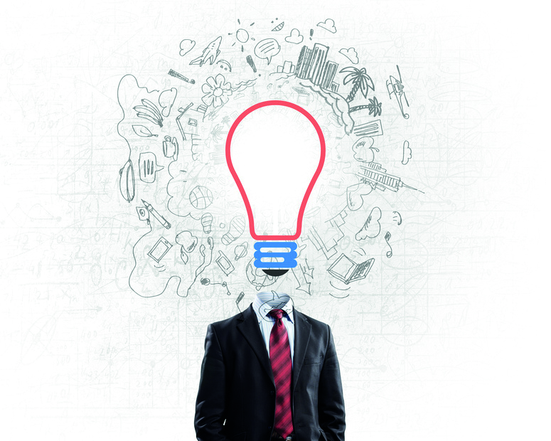 Idea concept with businessman and light bulb instead of his head